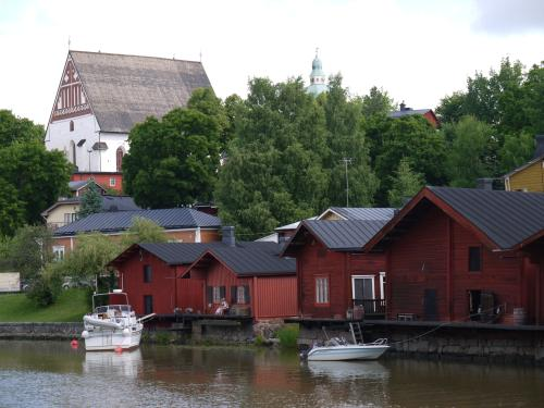 Landmark red wooden houses, church in the background, Porvoo